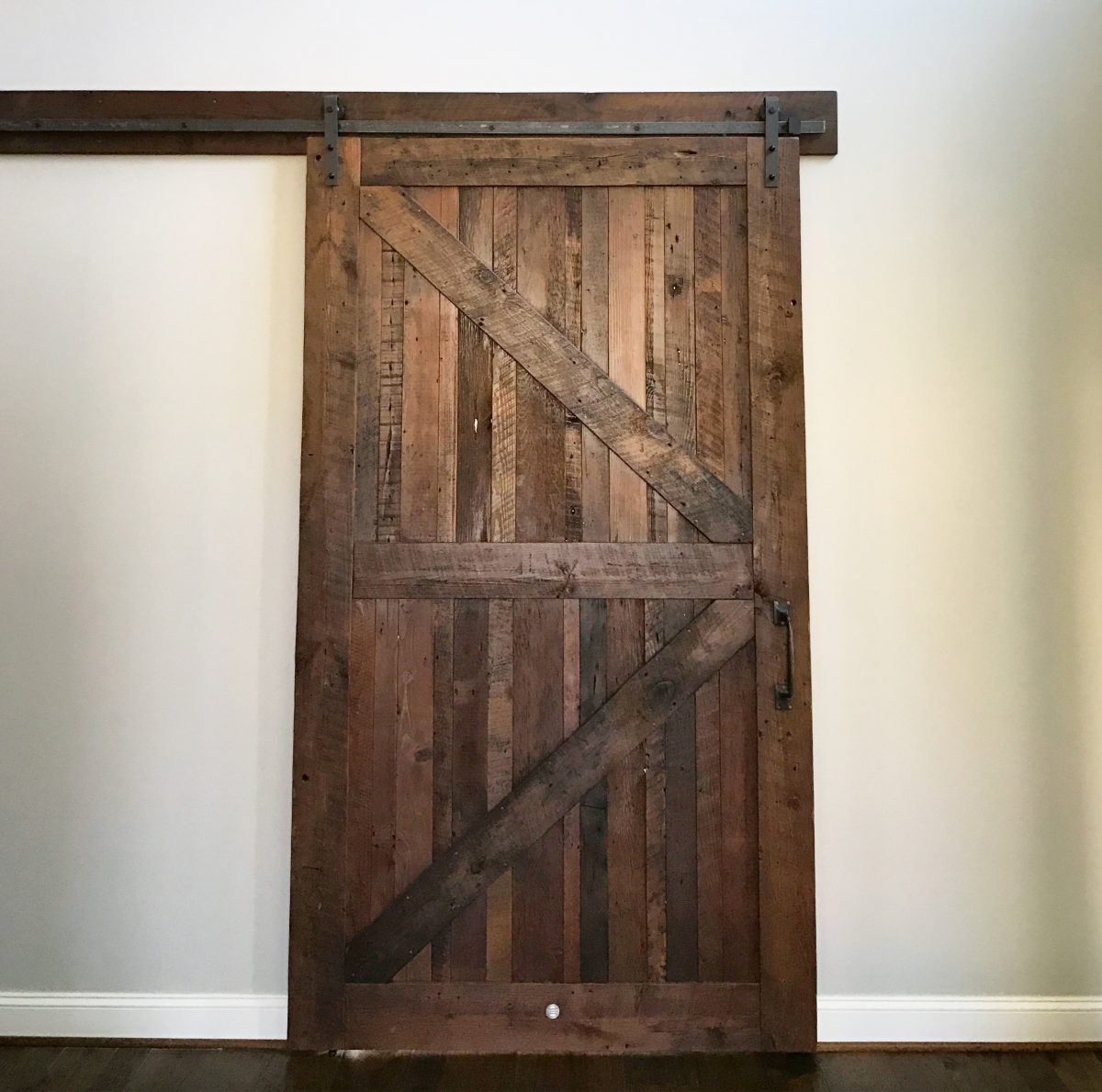 reclaimed cladded residence wood barns in barn doors